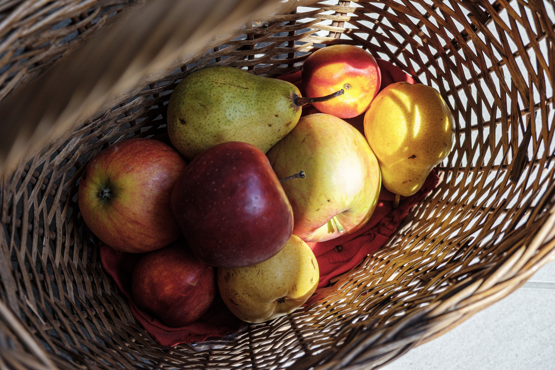 basket with apples and pears in it