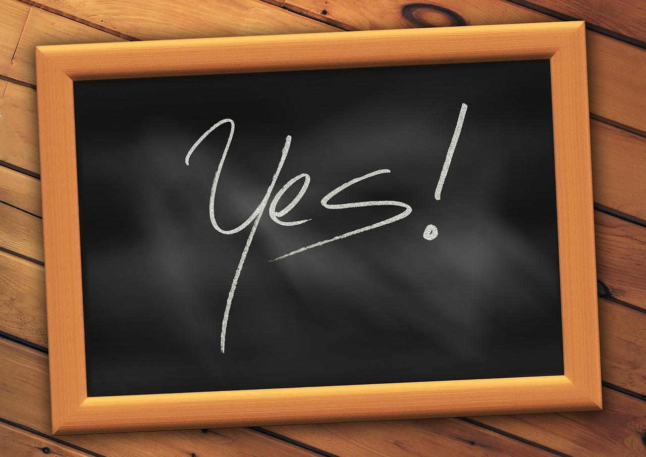 Blackboard with the word YES written on it