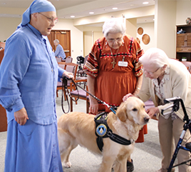 Sister Pauline Quinn, OP, Brings Healing to Prisoners Who Train Service Dogs