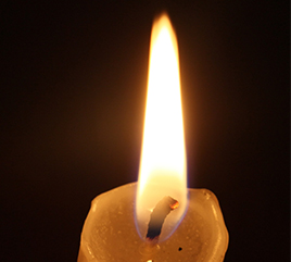 Single Lit Candle Brings Hope in Dark Place